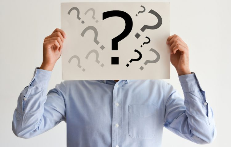 Employee or manager dilemma with question marks on blank paper